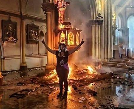 Chilean Protesters make Devil Signs as Churches burnt to ground