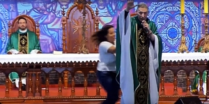 Brazil - Catholic Priest Pushed off Sanctuary during Live Mass