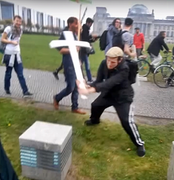 Aggressive Far left abortion activist smashes christian cross at March for Life Berlin