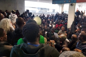 Paris - illegal Migrants storm Charles de Gaulle Airport