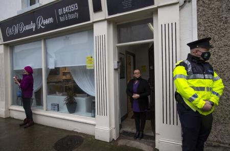 Gardai arrive at beauty salon, lockdown extended April 5 , schools reopen phased basis