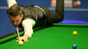 Reigning champion Selby beaten by Perry in first round