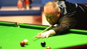 Higgins keeps two-frame lead over Wilson in semi-final