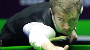 In-form Lisowski 'riding the wave' after reaching round two