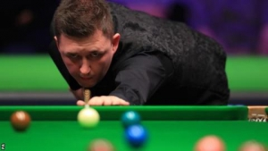 UK Championship: Kyren Wilson beats Barry Hawkins to progress