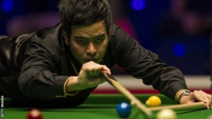 World Grand Prix: John Higgins loses to Noppon Saengkham