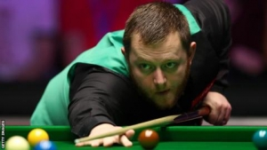 Allen concedes frame with 11 reds remaining to hand Carter the match