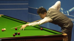 World Championship 2019: Ding Junhui turns match around to lead Judd Trump