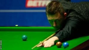Wilson stuns Hawkins to make Crucible last eight