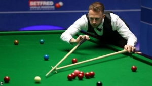World Snooker Championship: Judd Trump eases past Stephen Maguire to reach semi-finals