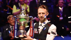 Judd Trump's 15-match winning run ended by Joe Perry in China