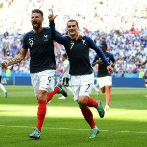 France into quarter-finals after seven-goal thriller