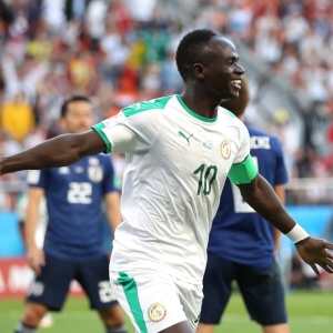 Group leaders Japan and Senegal share spoils