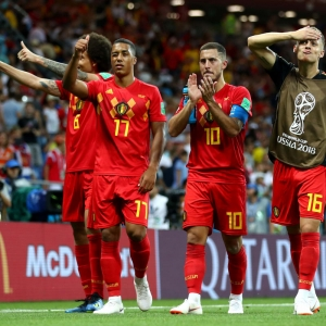 Belgium dig deep to edge out Japan